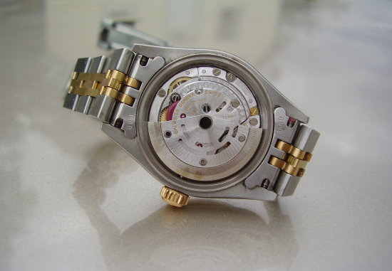 Rolex with case back open